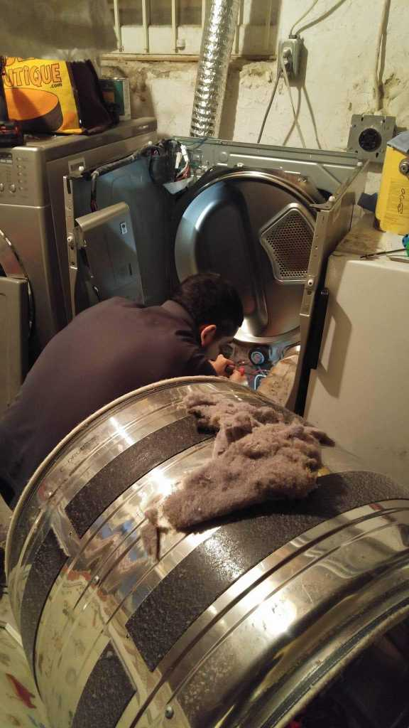 dryer lint cleaning in progress