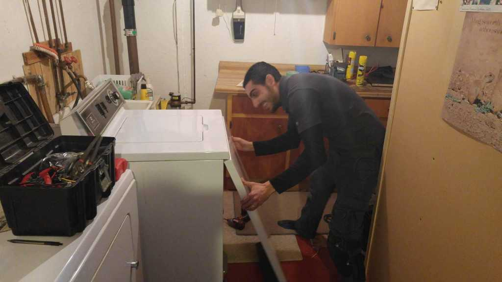 old model washer repair in a basement