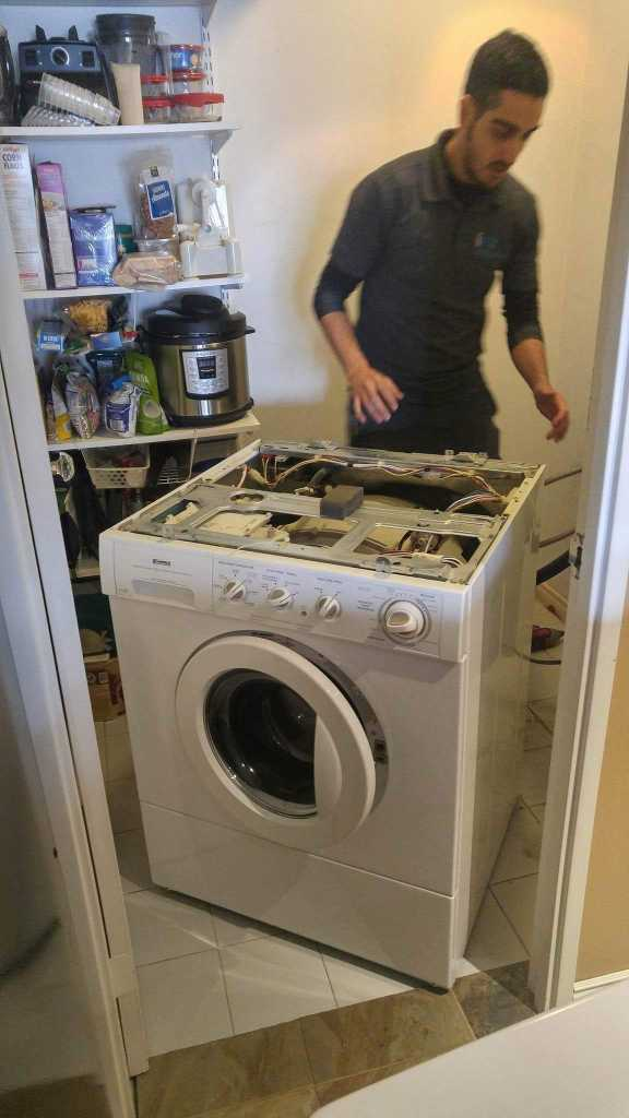 ifix appliance repair technician fixing a washer