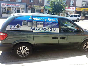 I-fix appliance repair technician vehicle with a car wrap appliance repair advertisement